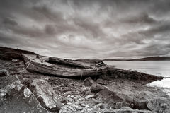 Old boat on Scottish beach Royalty Free Stock Photo