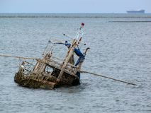 The old boat in the sea Royalty Free Stock Photo