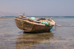 Old boat in sea. Old boat with garbage packs in Red sea Royalty Free Stock Image