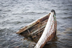 Old boat in the sea Stock Photo
