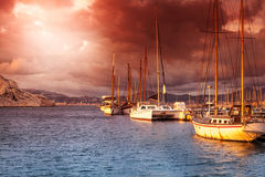 Old boat on the sea in the port at sunset Royalty Free Stock Photography