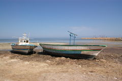 Old boat on sea shore royalty free stock photography