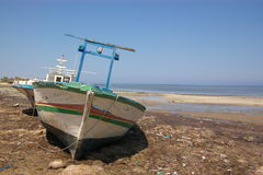 Old boat on sea shore Royalty Free Stock Photos