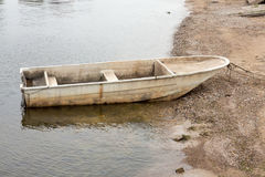 Old boat on the seashore Royalty Free Stock Photography