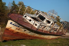 Old boat on the shore. Abandoned old boat on the lake Stock Photography