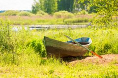 Old boat on the shore of a beautiful lake Stock Photo