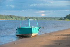 Old boat at the shore Stock Images