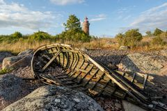 Old boat, shore and evening light Stock Photo