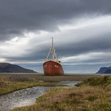 Old boat. On the shore of Iceland Stock Photos