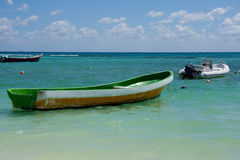 Old Boat Sitting at Sea. An old green and yellow boat sitting at sea on the beautiful waters of the Atlantic Ocean royalty free stock images