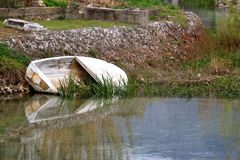 Old Boat. Small old boat abandoned in a river. In Solin, Croatia. Selective focus Royalty Free Stock Photo