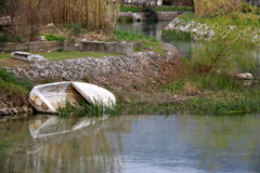 Old Boat. Small old boat abandoned in a river. In Solin, Croatia. Selective focus Royalty Free Stock Photos