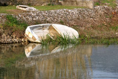 Old Boat. Small old boat abandoned in a river. In Solin, Croatia. Selective focus Stock Photo