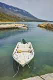 Old boat at small port before storm, Kefalonia, Ionian islands, Greece Stock Photo