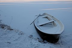 Old boat in the snow. Royalty Free Stock Images