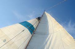 Old boat standing and running rigging - mainsail,staysaill,mast Stock Image