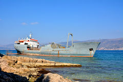 Old boat stranded on the shore Royalty Free Stock Photo