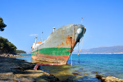 Old boat stranded on the shore Stock Photo