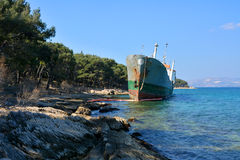 Old boat stranded on the shore Stock Image