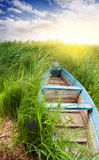 Old boat at the sunset. Stock Image