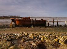 Old Boat shipwreck at sunset Stock Photo