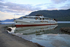 Old boat on Teletskoye Lake in Altai mountains, Russia Royalty Free Stock Photos