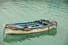 Old boat. On tranquil green water Stock Photo