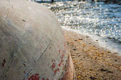 Old Boat Upside Down on the Beach Stock Photography