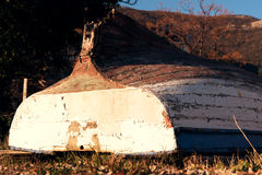 Old boat upturned on grass Royalty Free Stock Images