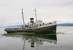 Old boat from Ushuaia,. With lake reflection Stock Photos