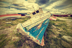 Old boat wreck, vintage retro style. Royalty Free Stock Photo