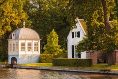 Old boathouse alongside the Dutch Vecht river stock photography