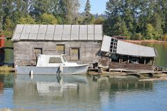 Old Boathouse in Disrepair. An old boathouse on the river is showing signs of disrepair and is no longer being used Stock Images