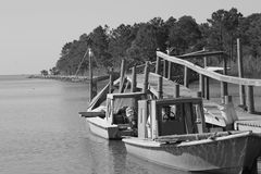 Old boats. Tied up to a damaged dock Royalty Free Stock Photo