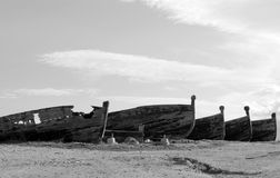 Old Boats. Vessels abandoned on the beach, once used for fishing tuna Stock Photo