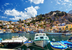 Old boats docked in the gulf of Symi island in Greece Royalty Free Stock Photos