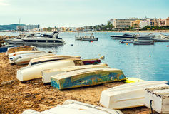 Old boats on the empty beach of Ibiza. Balearic Islands, Spain Royalty Free Stock Image