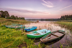 Old boats. Five old boats on the lake shore Royalty Free Stock Photography