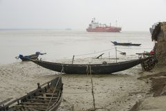 Old boats and the gas tanker, Mongla, Bangladesh. Stock Photos
