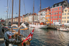 Old boats and houses in Nyhavn in Copenhagen Stock Image