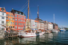Old boats and houses in Nyhavn in Copenhagen Stock Images
