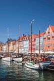 Old boats and houses in Nyhavn in Copenhagen Royalty Free Stock Photography