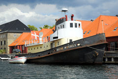 Old boats in Kobenhavn, Copenhagen, Denmark. View on Kobenhavn with a large and small old fishing boats, Copenhagen, Denmark royalty free stock photography