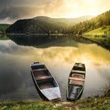 Old boats at a lake stock images