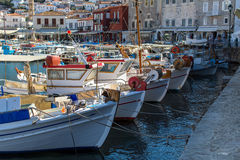 Old boats at the pier of Hydra island Stock Images