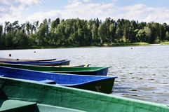 Old boats at the pier. Of the lake in summer day Stock Image