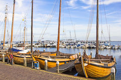 Old boats in the port of Volendam Stock Images