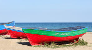 Old boats. Resting on the beach in Badalona, (Barcelona) Spain Royalty Free Stock Image