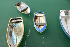 Old boats. Old rowing boats moored in the harbour Royalty Free Stock Images