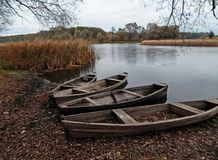 Old boats on the shore. Old boats on the river bank. Russia Royalty Free Stock Photo